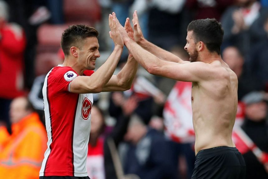 Southampton's Dusan Tadic celebrates with Shane Long at the end of the match.