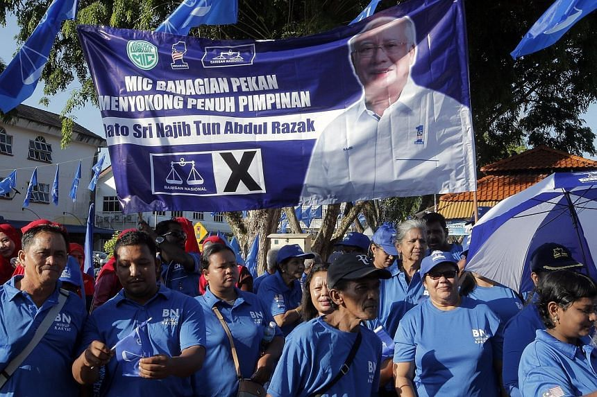 Supporters of Prime Minister Najib Razak in the state of Pahang yesterday where he filed his nomination papers to stand in Pekan.