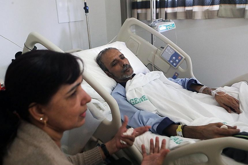 Mr Ajit Singh at a healthier weight before the lung cancer struck. He said workers were given flimsy masks that did not protect them from asbestos. Mr Ajit Singh, who was found to have lung cancer early last year, with his wife Koldip Kaur. The 57-ye