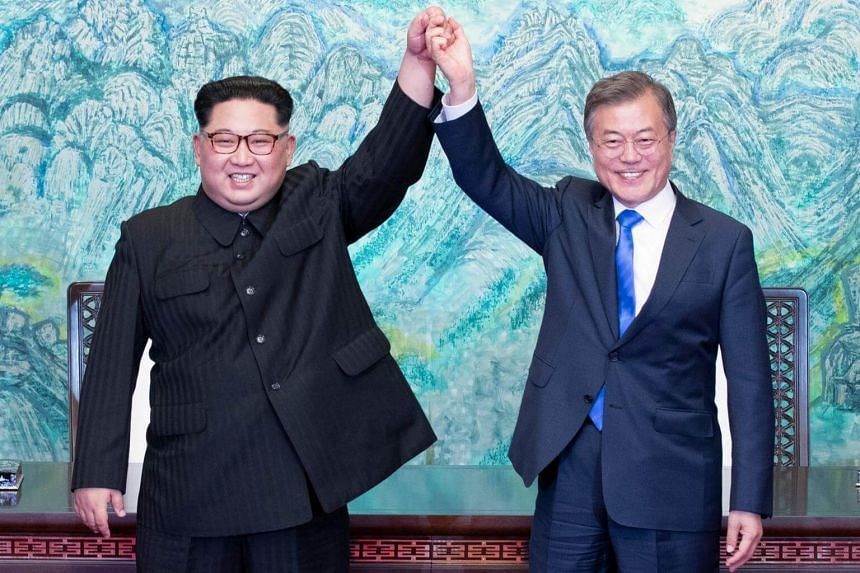 North Korean leader Kim Jong Un (left) promised to change the time zone back during the historic summit with South Korean President Moon Jae In.