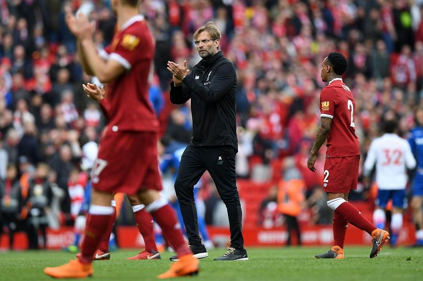 Liverpool's German manager Jurgen Klopp (centre) gestures at the final whistle during the English Premier League football match between Liverpool and Stoke City at Anfield in Liverpool, on April 28, 2018.
