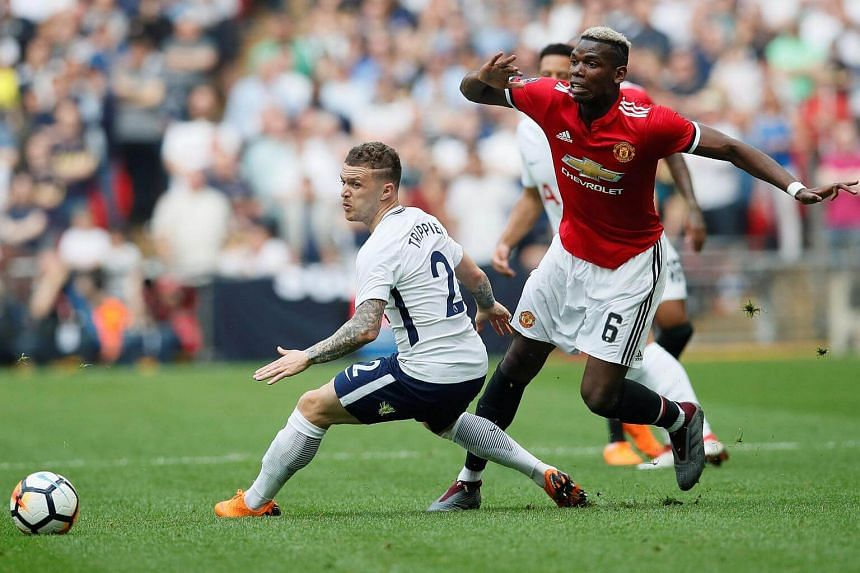 Manchester United's Paul Pogba (right) in action with Tottenham's Kieran Trippier.