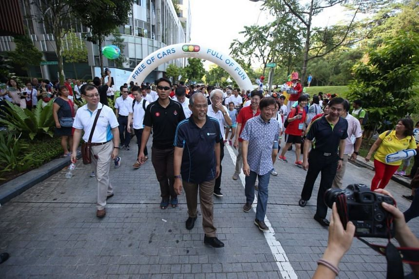Transport Minister Khaw Boon Wan and Environment and Water Resources Minister Masagos Zulkifli at a walkabout held during the first Car-Free Sunday outside the Civic District.