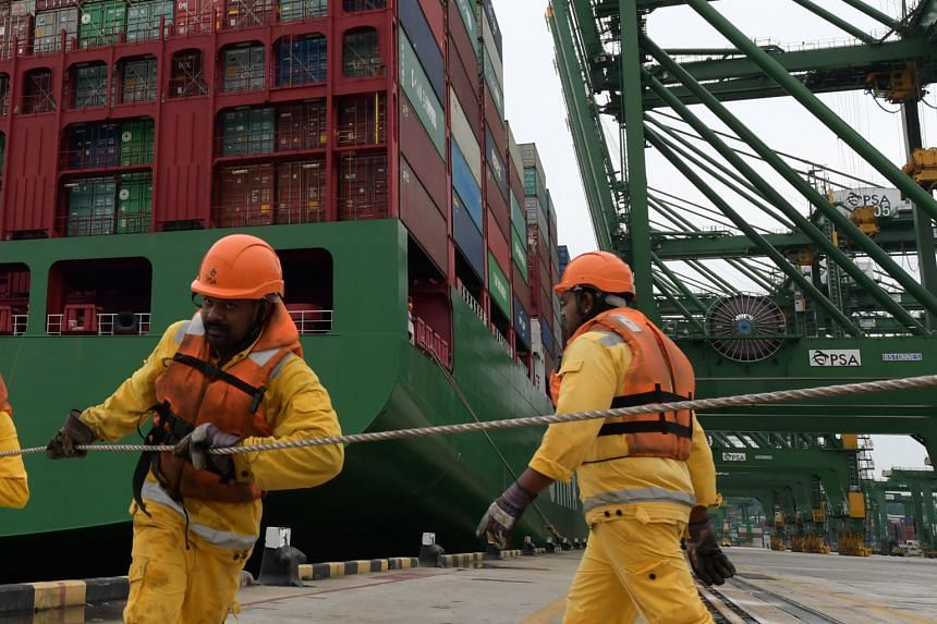 Workers at the Pasir Panjang Terminal. One way of dealing with a potential trade war is to look to South-east Asia for new opportunities.