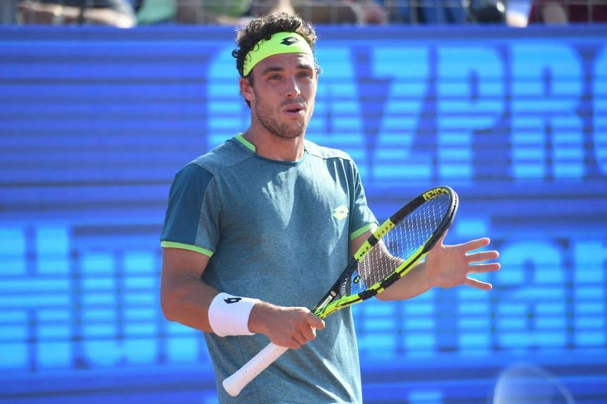 Cecchinato reacts after a point against his compatriot Andreas Seppi.