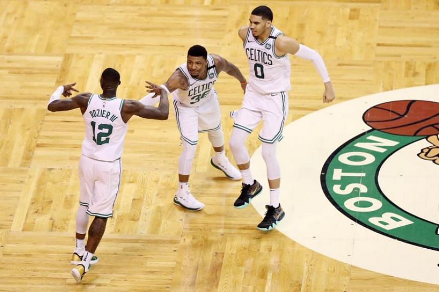 (From left) Terry Rozier, Marcus Smart and Jayson Tatum of the Boston Celtics celebrating after winning their NBA playoff series against the Milwaukee Bucks, on April 28, 2018.
