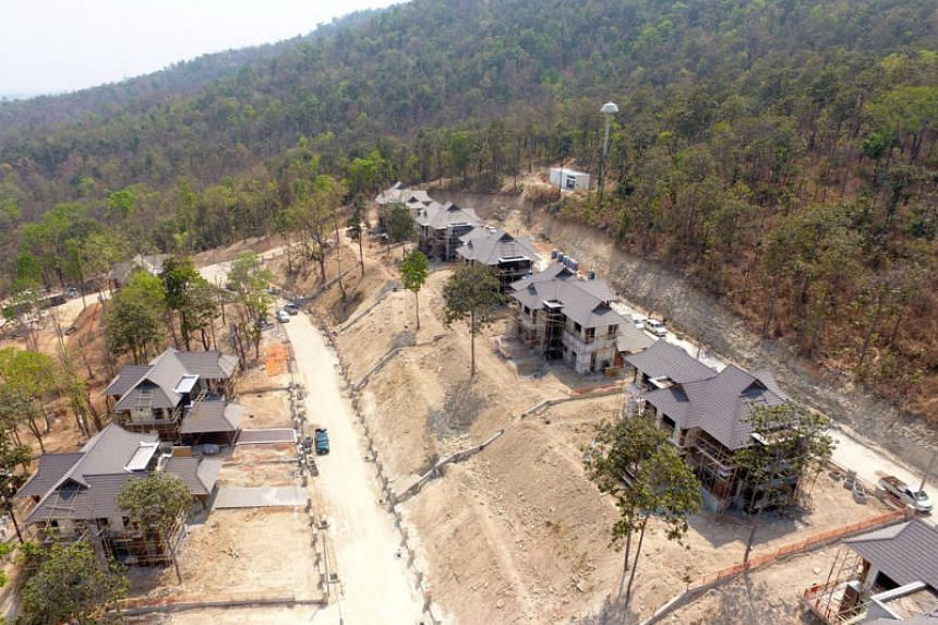 Partially constructed houses that are part of the Court of Justice's 955-billion-baht housing project in Chiang Mai.