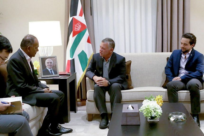 Minister for Home Affairs and Law K. Shanmugam speaking with King Abdullah II of Jordan.