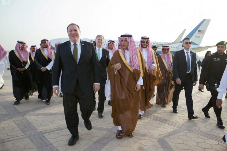 US Secretary of State Mike Pompeo speaking with Saudi Foreign Minister Adel Al-Jubeir (centre) after arriving in Riyadh on April 28, 2018.