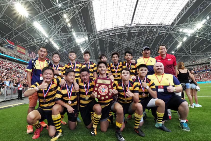 ACS (I) captain Ng Zu Jie (centre, with shield) and his team posing after defeating St Andrew's Secondary School in the Under-14 Singapore Schools Sevens Series, on April 29, 2018.