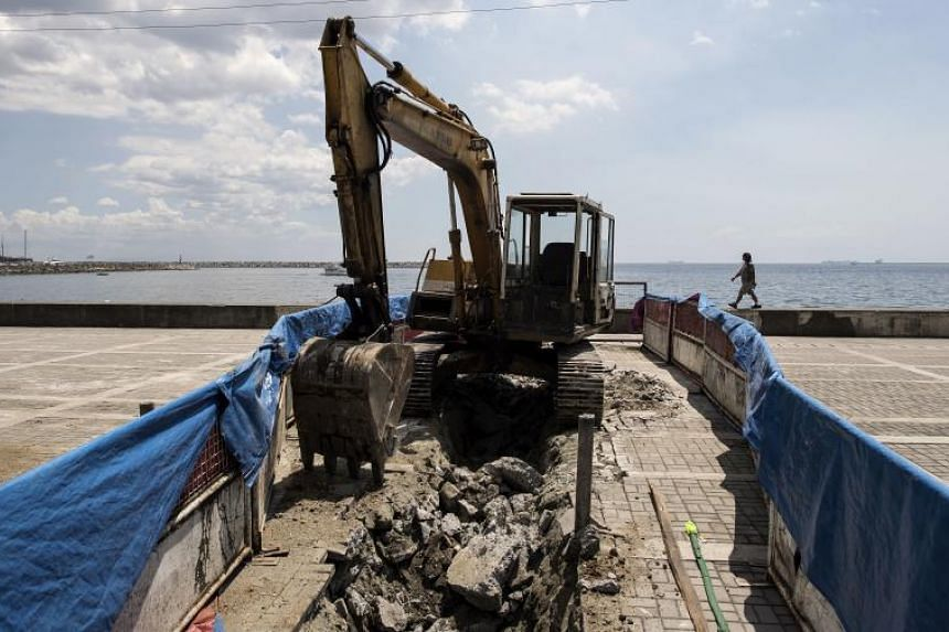 """A backhoe is seen at the site where a memorial statue for World War II """"comfort women"""" was once situated, in Manila on April 28, 2018."""