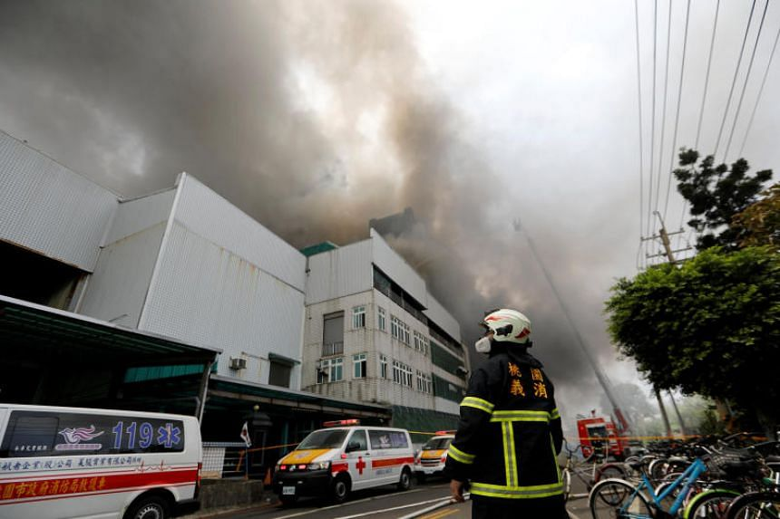 Emergency services personnel deploying at the site of the factory fire in Taoyuan, Taiwan, on April 29, 2018.
