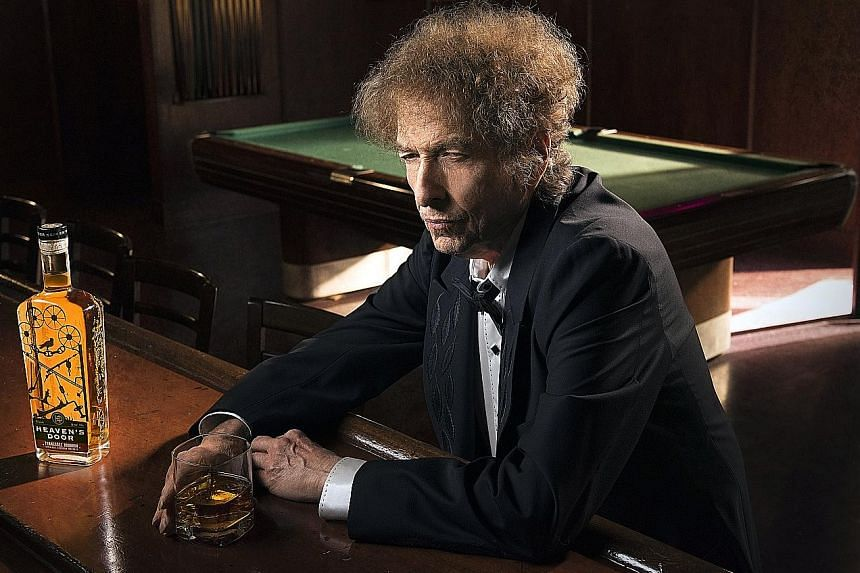 """Bob Dylan in a promotional photograph (left) for his Heaven's Door whiskeys, which comprise (above from left) a straight bourbon, a """"double-barrelled"""" whiskey and a straight rye."""