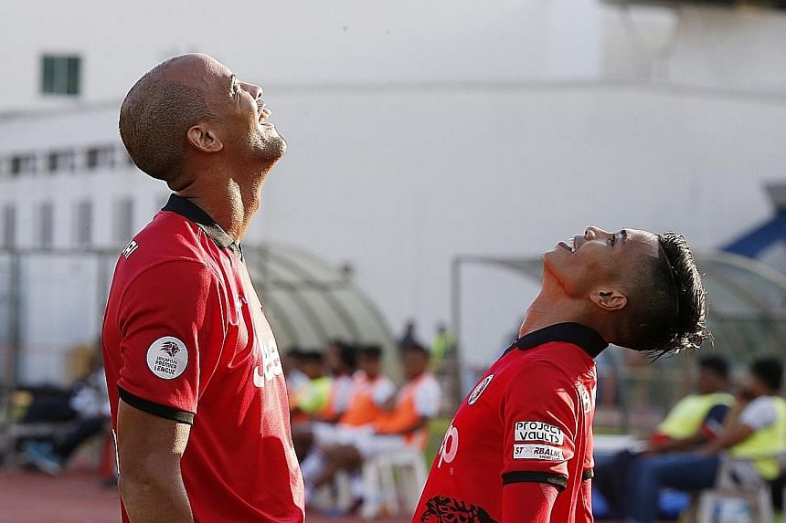 Keegan Linderboom (left) and Hazzuwan Halim celebrating after Linderboom scores the first goal for Balestier Khalsa. The Tigers overcame Warriors at Toa Payoh Stadium to move to second behind Albirex Niigata.