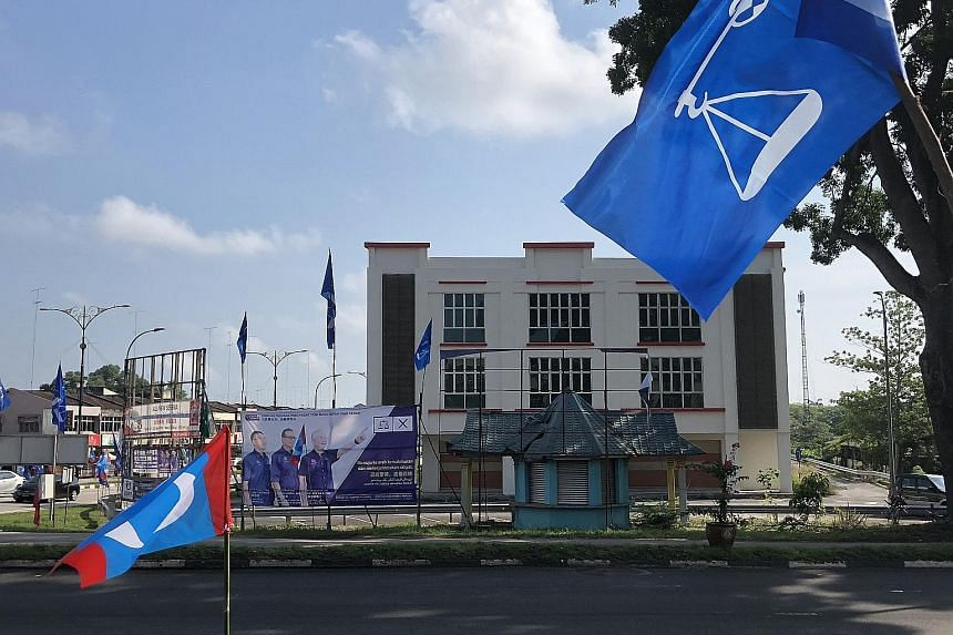 Left: The opposition billboard in Yong Peng, Johor, showing BN's Dr Wee Ka Siong with Prime Minister Najib Razak and his wife, and the empty space after the EC removed it. Above: Opposition candidate Liew Chin Tong in front of a BN poster of Transpor