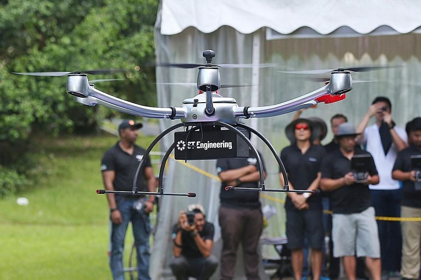 A drone demonstration by ST Aerospace during Car-Free Sunday SG at one-north yesterday, the first such event to be held outside the Civic District and Telok Ayer. Members of the public can submit feedback on the CAAS' proposed amendments until May 31