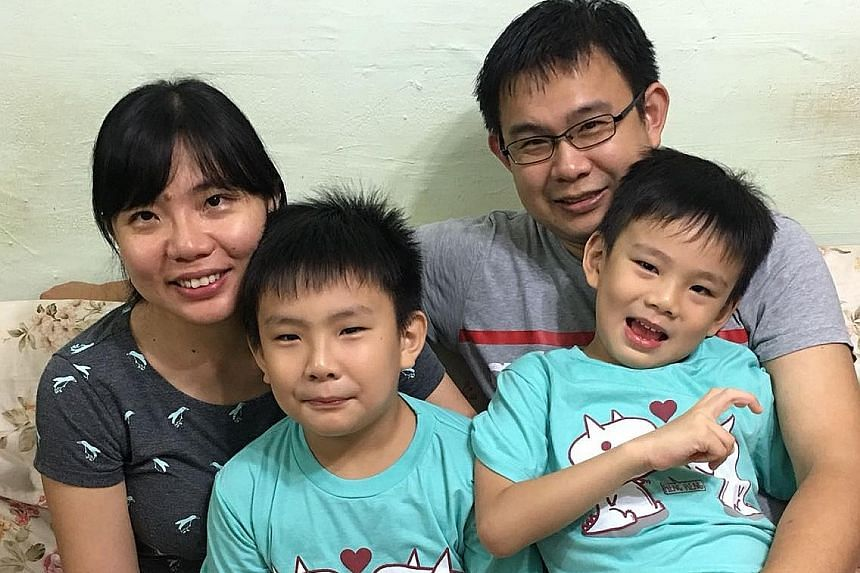 Finance manager Tony Lai, 39, with his wife Yvonne Chang, 35, and their sons Jordan (left), seven, and Lebron, six. The family signed up for the ST Run for the first time last year, and will be back this year.