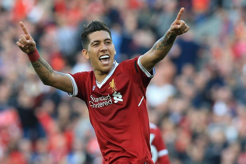 Liverpool's Roberto Firmino celebrates after scoring against Bournemouth at Anfield on April 14, 2018.