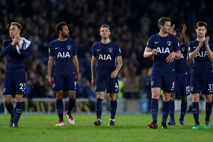 Tottenham players salute their fans after their match against Brighton & Hove Albion on April 17, 2018.