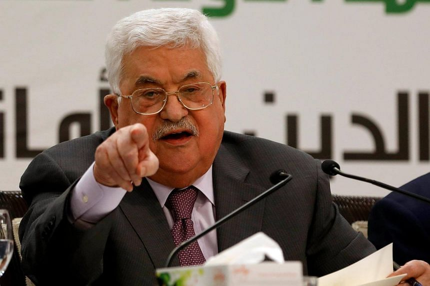 Palestinian President Mahmoud Abbas gestures as he speaks during a conference, in Ramallah in West Bank, on April 11, 2018.