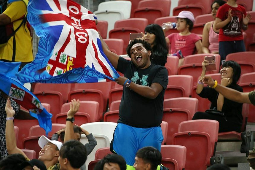 A Fiji fan cheers after the team victory against Australia in the gold medal match on the final day of the Singapore leg of the HSBC World Rugby Sevens Series at National Stadium, on April 29, 2018.