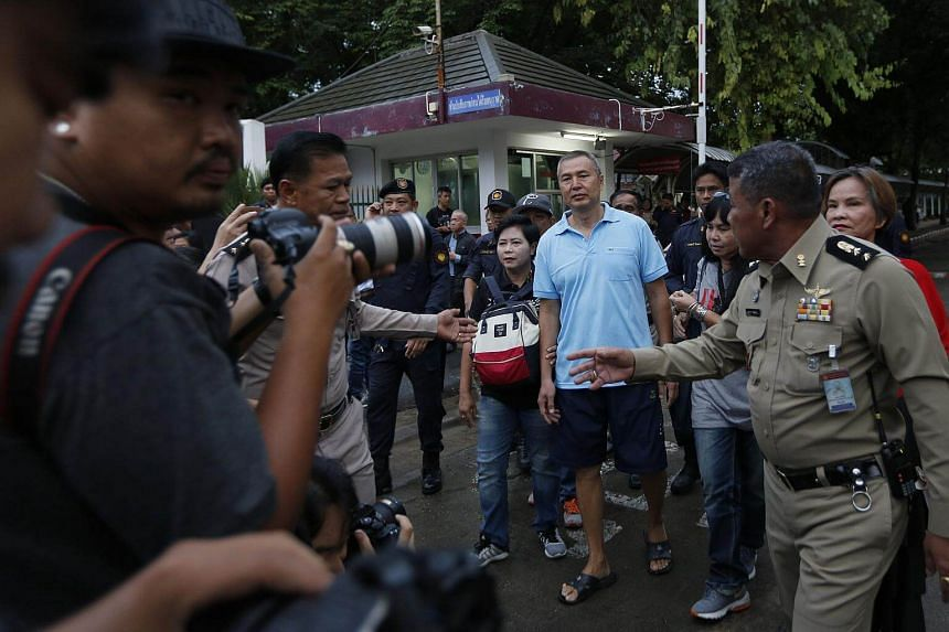 Thai activist Somyot Prueksakasemsuk (centre, in blue) walks with his supporters as he is released from the Bangkok Remand Prison, on April 30, 2018.
