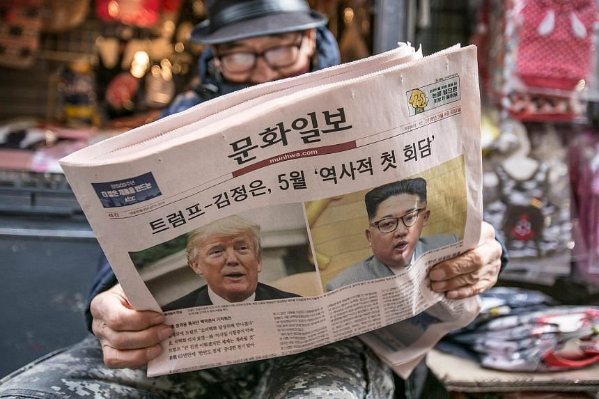 A man reads the Munhwa Ilbo newspaper featuring US President Donald Trump and North Korean leader Kim Jong Un in Seoul, South Korea, on March 9, 2018.