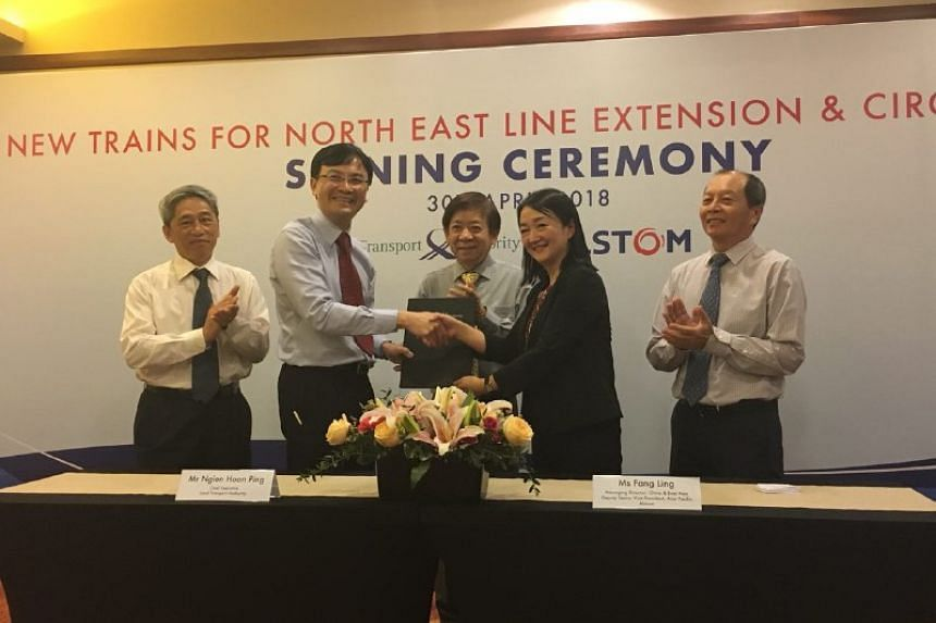 (From left) LTA's Senior Group Director for Rail Sim Wee Meng, LTA chief executive Ngien Hoon Ping, Transport Minister Khaw Boon Wan, Alstom's managing director for China & East Asia and deputy senior vice president for Asia Pacific Fang Ling, and Al