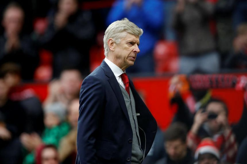 Arsenal manager Arsene Wenger looks dejected after the match between Manchester United and Arsenal at Old Trafford, Manchester, Britain on April 29, 2018.