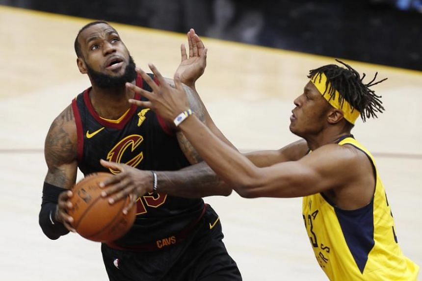 LeBron James (left) of the Cleveland Cavaliers goes to the basket against Myles Turner of the Indiana Pacers during the first half of game 7 of the Eastern Conference First Round Playoffs at Quicken Loans Arena in Cleveland, Ohio on April 29, 2018.