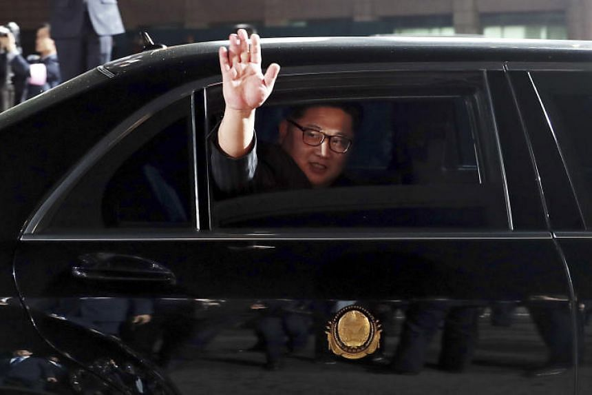 North Korean Leader Kim Jong Un waves from a car as he departs the Inter-Korean Summit held in the truce village of Panmunjom, South Korea on April 27, 2018.