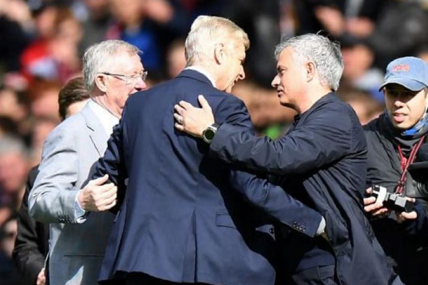 Arsenal's French manager Arsene Wenger (centre) is greeted by Manchester United's former manager Alex Ferguson (left) and Manchester United's Portuguese manager Jose Mourinho (right) during a presentation before the EPL match at Old Trafford in Manch