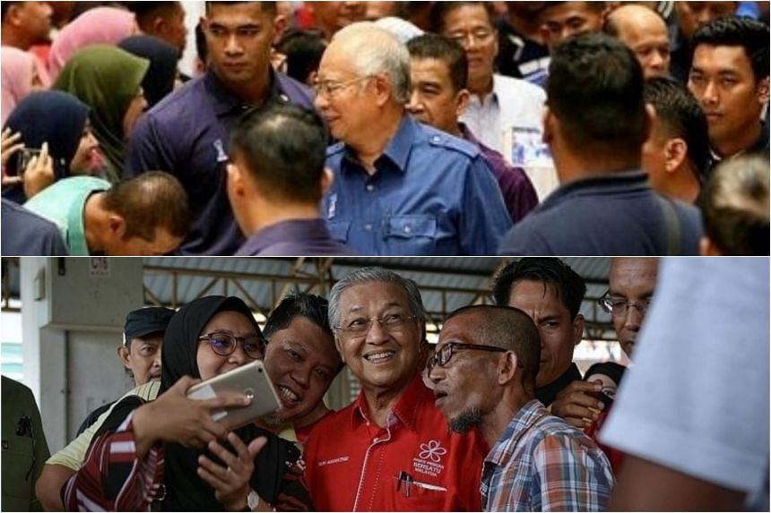 Prime Minister Najib Razak (top) attending a Teachers' Day celebration in Pekan, Pahang, and former premier Mahathir Mohamad (bottom) posing for photos with people at Pasar Kuah in Langkawi.