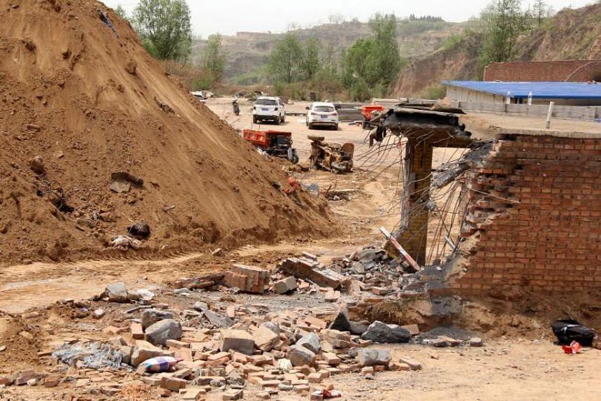 Damaged caused by the landslide in Caijiazhuang village.