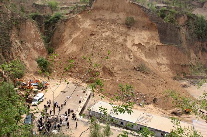 A general view of the aftermath of the landslide in Caijiazhuang village.