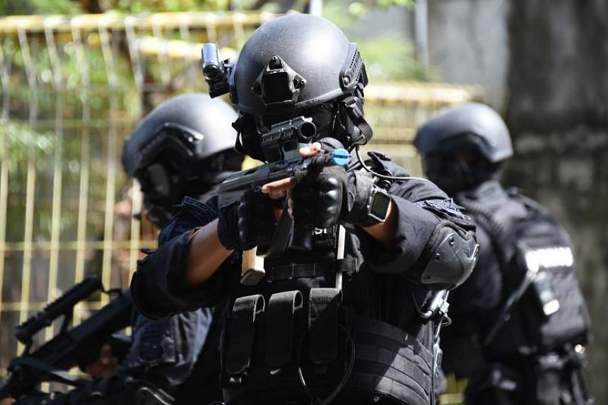 Indonesia anti-terror police take a part in a counter terrorism exercise at Benoa harbour in Indonesia on March 8, 2018.