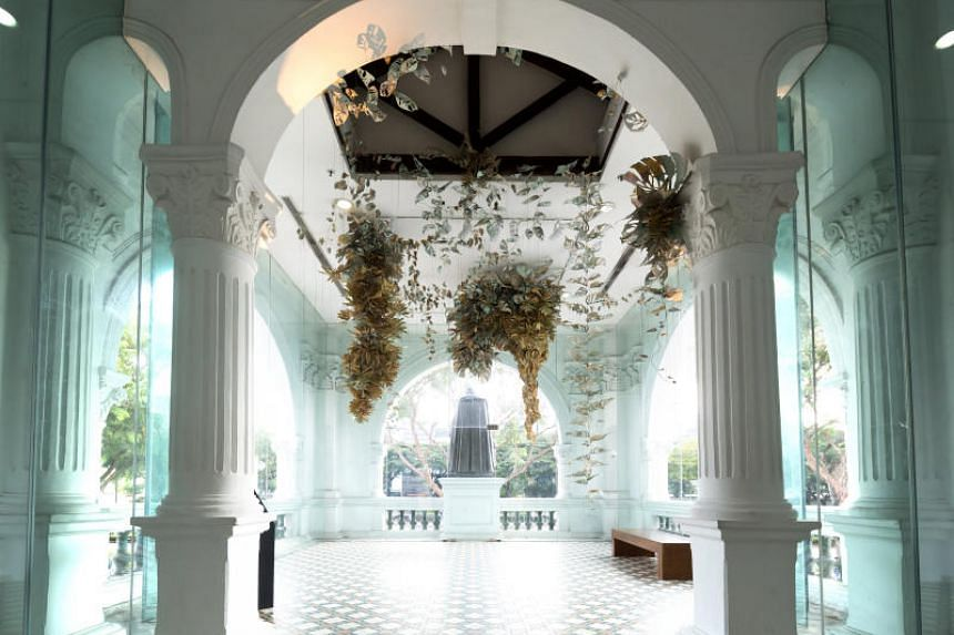 Filipino artist Ryan Villamael's paper-and-felt installation, Locus Amoenus, is suspended from the ceiling of the second floor of Singapore Art Museum during the Singapore Biennale.