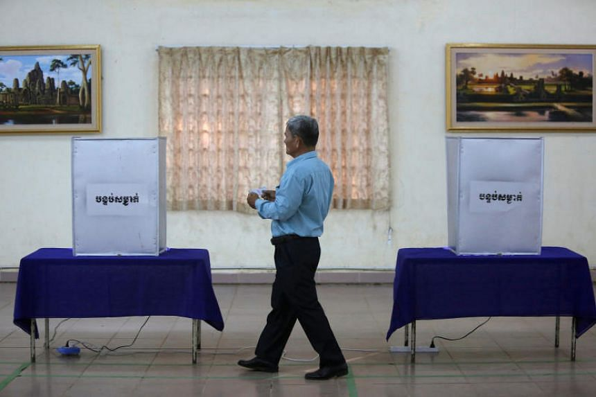 File photo showing a voter approaching a ballot box in the Kandal province of Cambodia.
