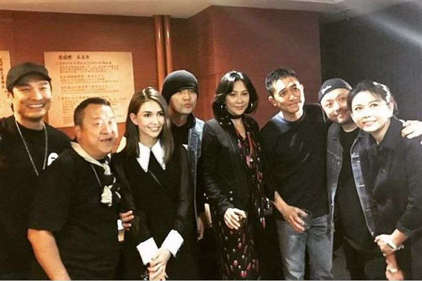 Celebrities at the Taipei concert of Jacky Cheung included (from left) Alex To, Eric Tsang, Hannah Quinlivan, Jay Chou, Carina Lau, Tony Leung Chiu Wai, Sham Kar Wai and his wife, former actress Chingmy Yau.