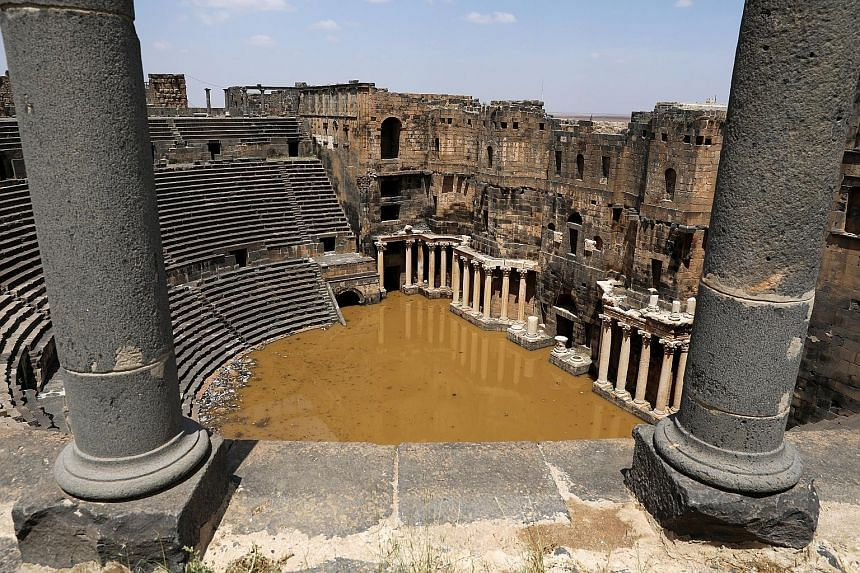 The 2nd-century Roman amphitheatre in the historic southern town of Bosra al-Sham, Syria, is partially submerged following heavy rain last week. The raging conflict in Syria has seen the destruction of six Unesco world heritage sites, including the a