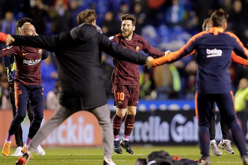 Lionel Messi celebrating Barcelona's LaLiga title win with his team-mates after they won 4-2 at Deportivo La Coruna on Sunday. Barcelona are four games away from finishing the season unbeaten in the league.