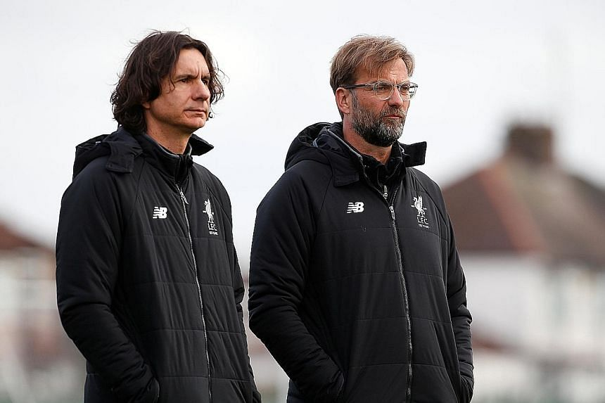 Liverpool manager Jurgen Klopp (right) and assistant manager Zeljko Buvac at the Premier League club's Melwood training ground last month.