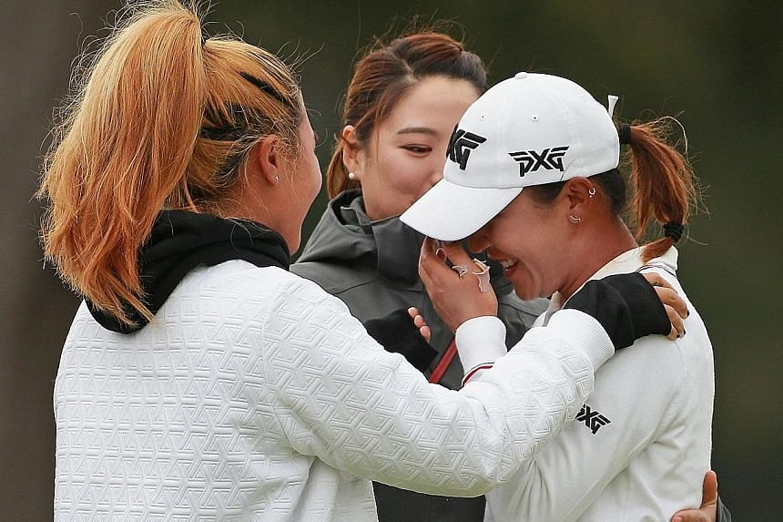 An emotional Lydia Ko being hugged by friends after beating Australia's Minjee Lee in a play-off to win the Mediheal Championship at Lake Merced Golf Club in Daly City, California on Sunday.