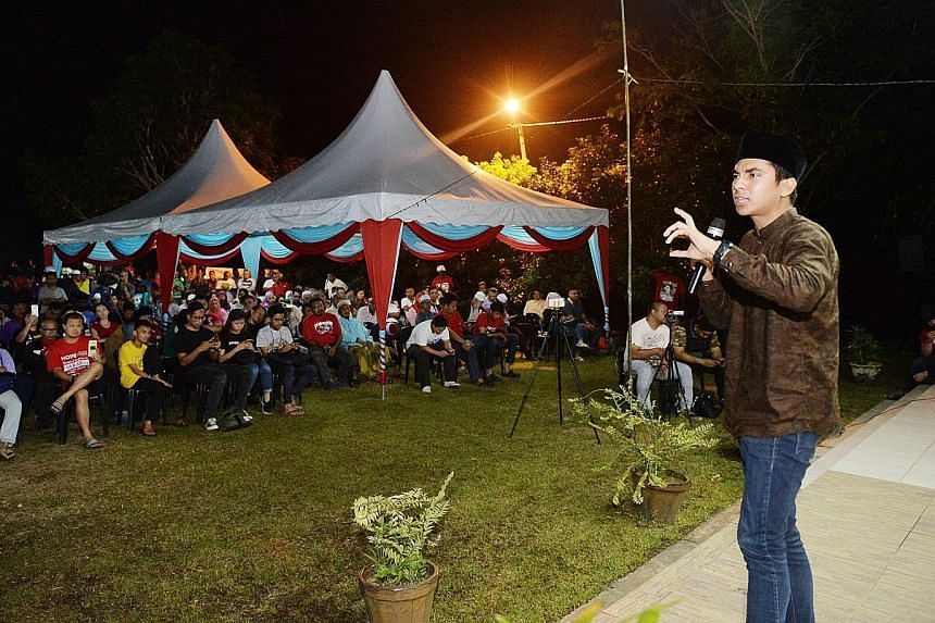 Above: Mr Syed Saddiq Syed Abdul Rahman, 25, who is contesting in the Muar parliamentary ward, speaking at a Pakatan Harapan rally last night in the Johor town. PH candidates say they are confident of a significant shift in Malay support in their fav