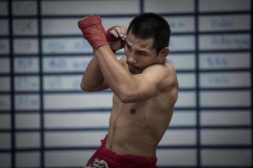 Current World Boxing Council mini-flyweight champion, Wanheng Menayothin, warms up during a training session in Bangkok, on Jan 31, 2018.