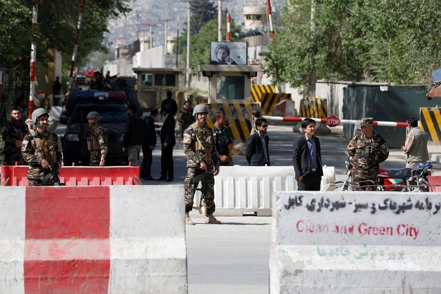 Afghan security forces stand guard near the site of a blast in Kabul, on April 30, 2018.