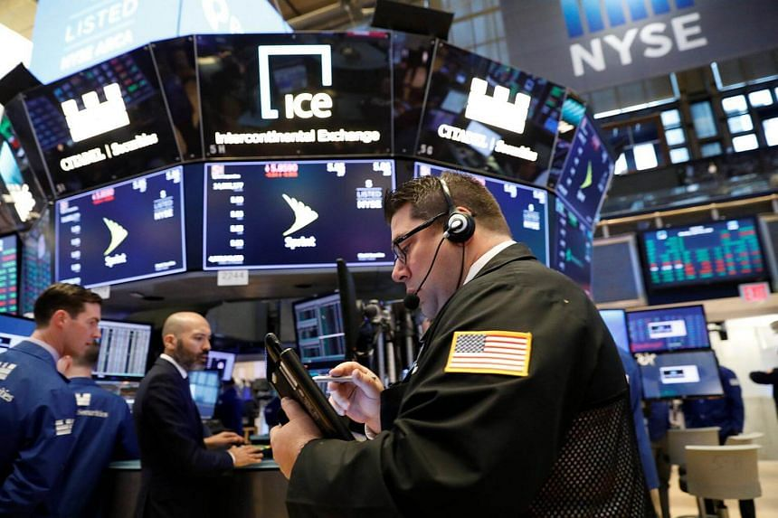 Traders work on the floor of the New York Stock Exchange in New York, US on April 30, 2018.