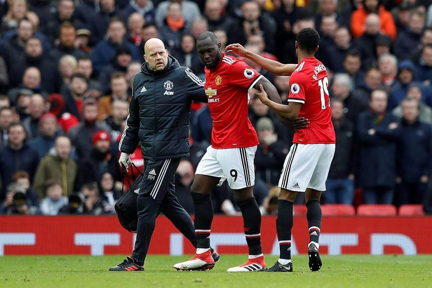 Manchester United's Marcus Rashford comes on as a substitute to replace Romelu Lukaku (centre) after he sustains an injury during their Premier League match against Arsenal at Old Trafford, on April 29, 2018.