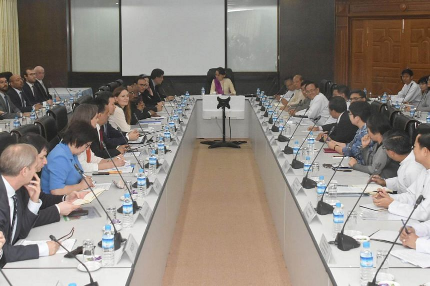 Myanmar State Counsellor Aung San Suu Kyi (centre) meeting the United Nations Security Council delegation (seen at left panel) in capital Naypyidaw, on April 30, 2018.