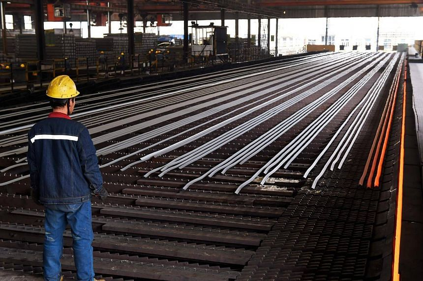 A worker stands in a steel workshop in Zouping, in China's eastern Shandong province, on March 10, 2018.